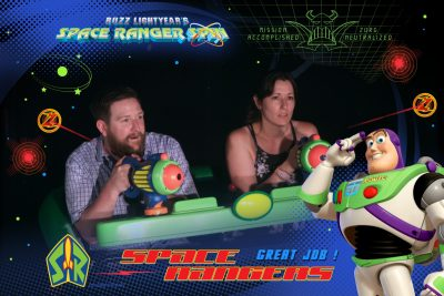 Buzz Lightyear's Space Ranger Spin On-Ride Photo of Ryan and Lauren